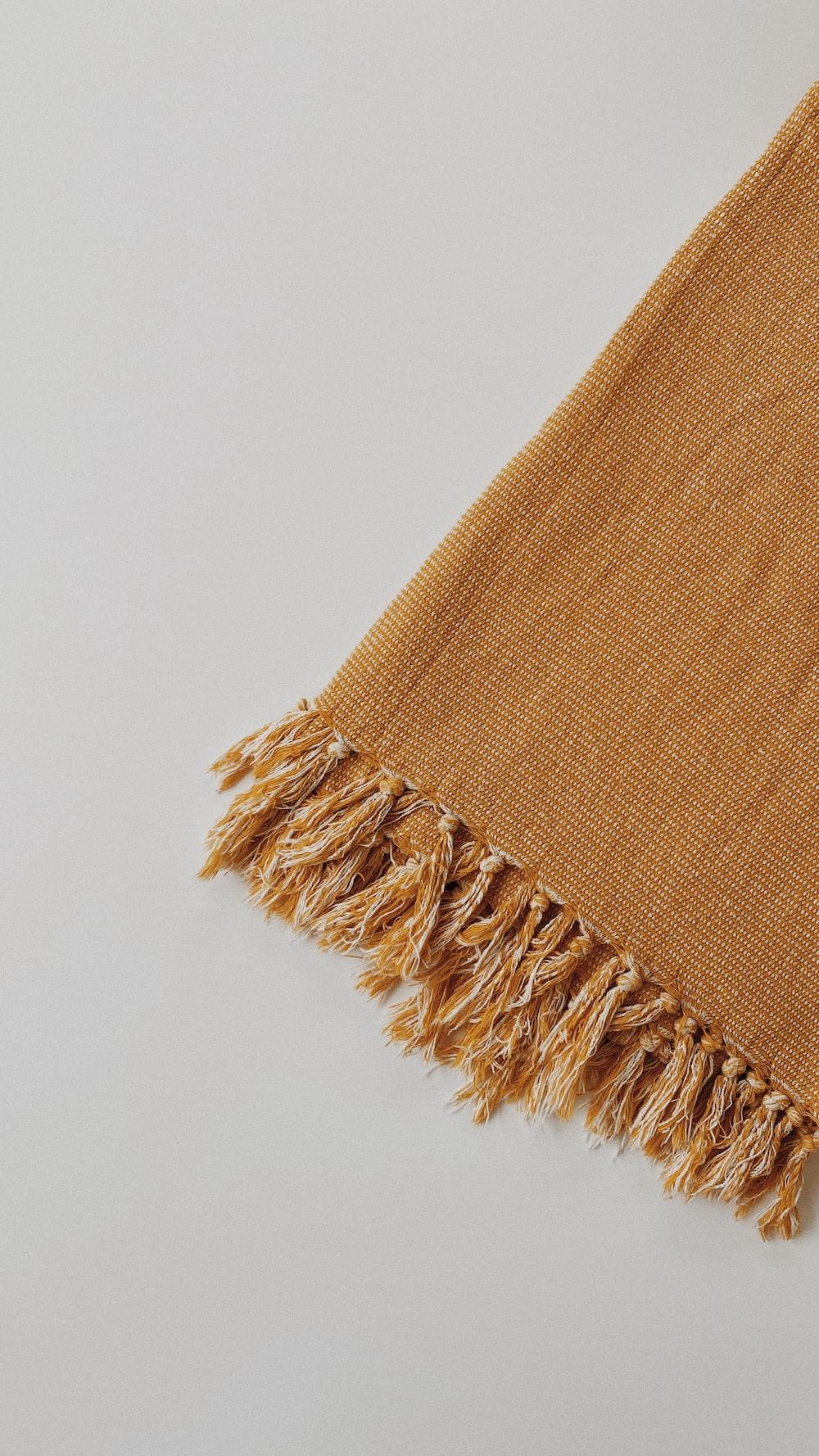 brown textile on white table