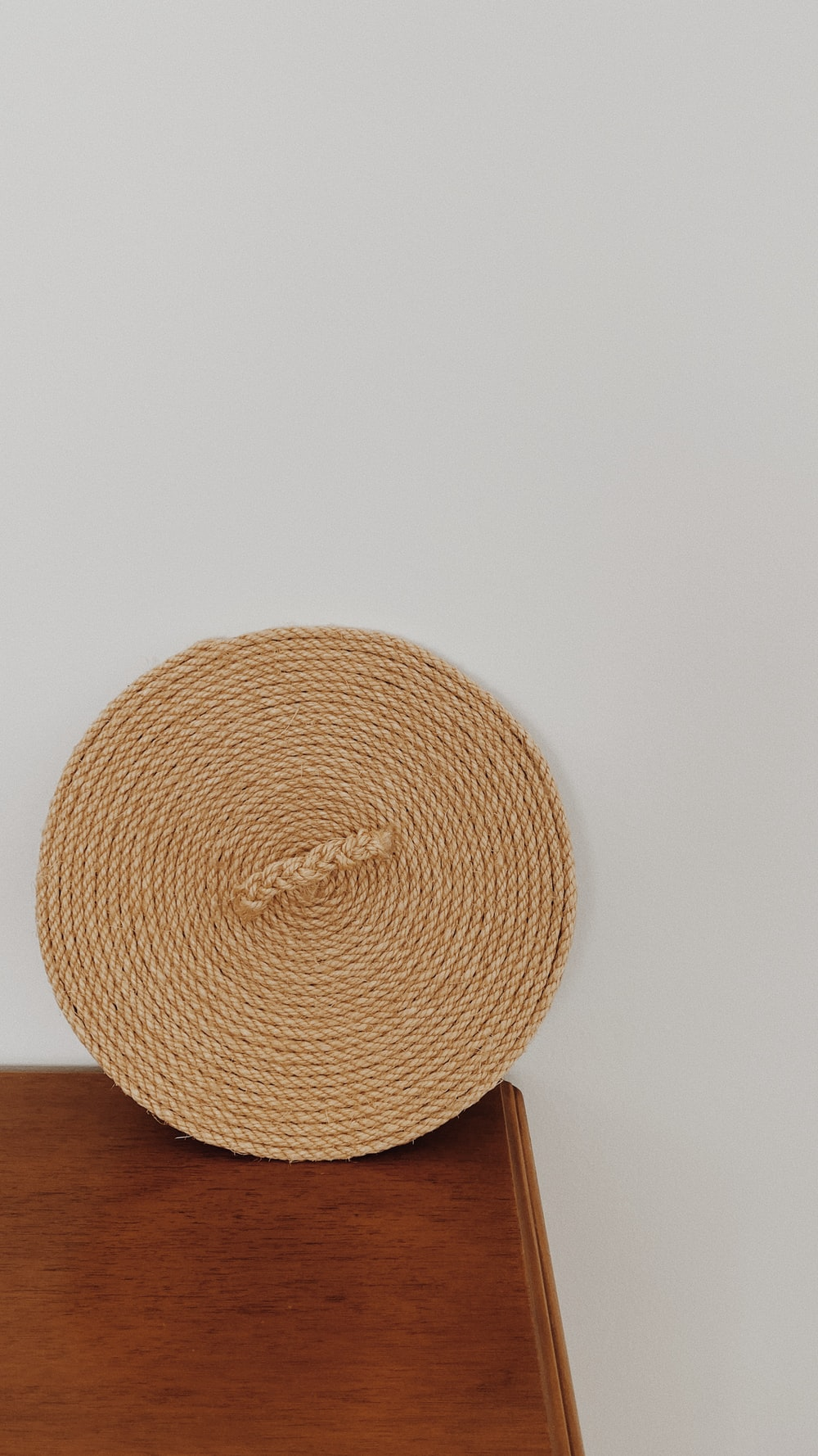 brown round woven round table mat