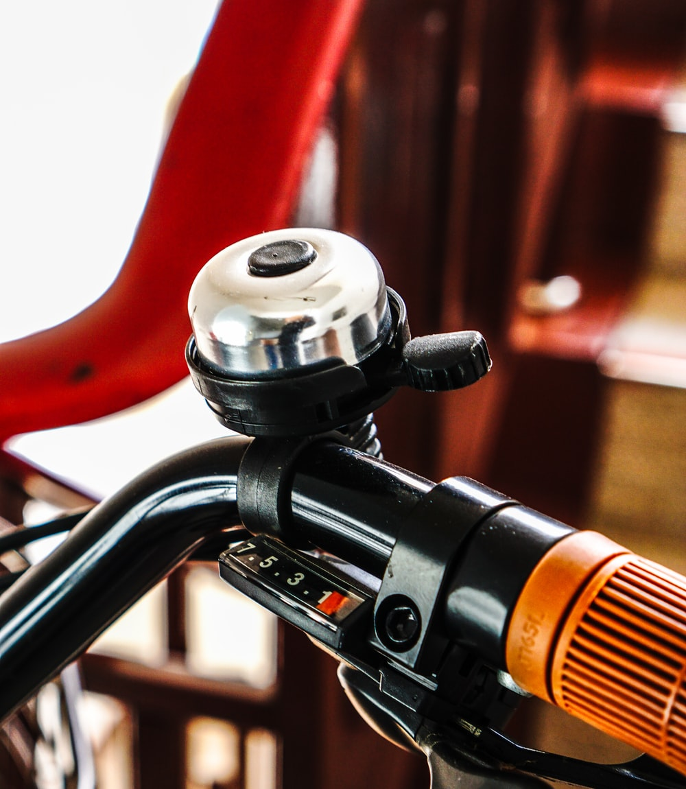 black and red bicycle handle bar