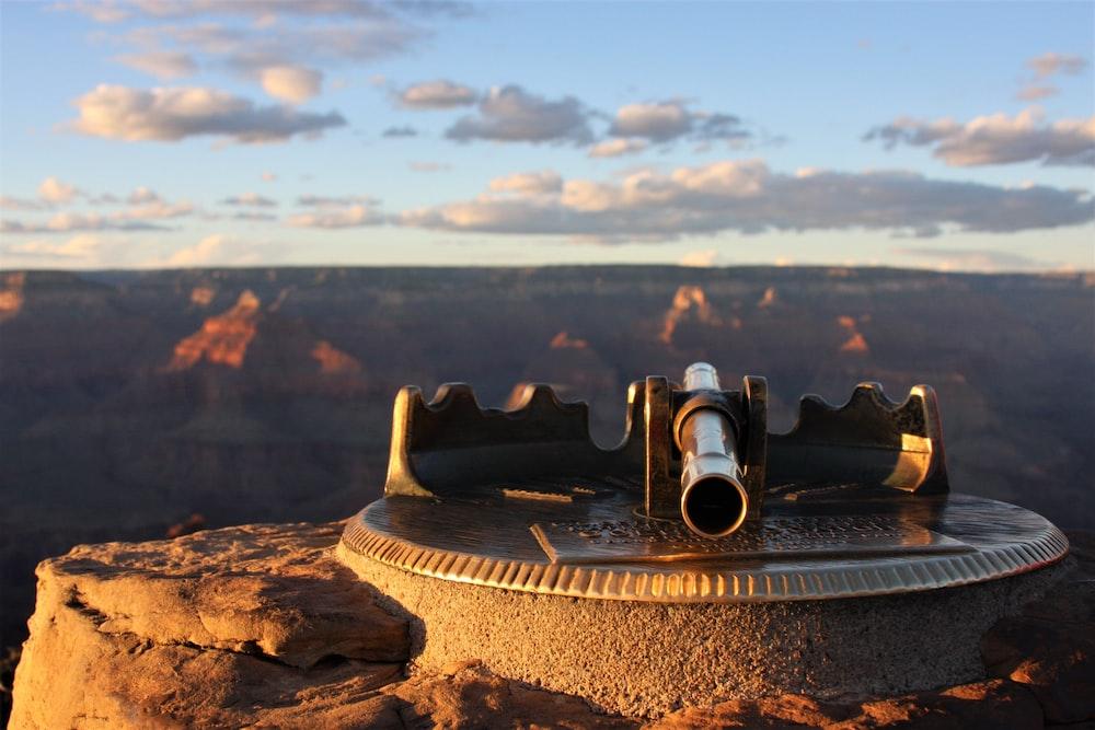 black binoculars on brown rock during daytime
