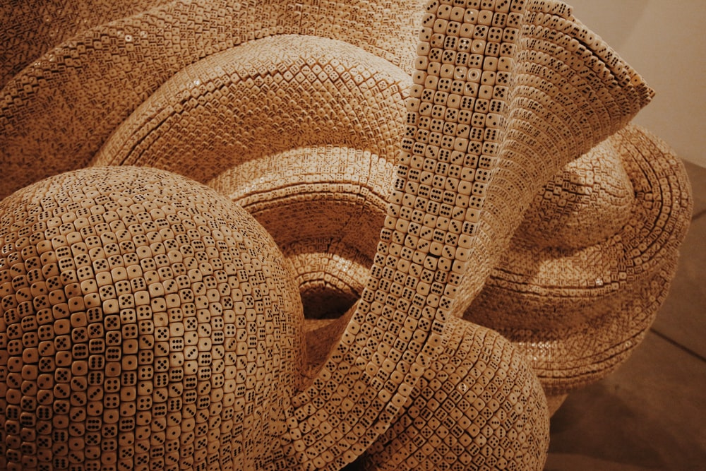 brown and beige textile in close up photography