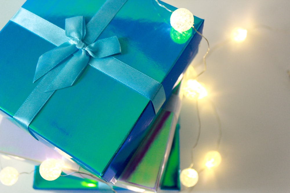 green gift box with white ribbon