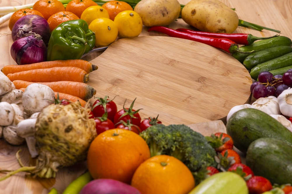 orange and green vegetables on brown wooden table