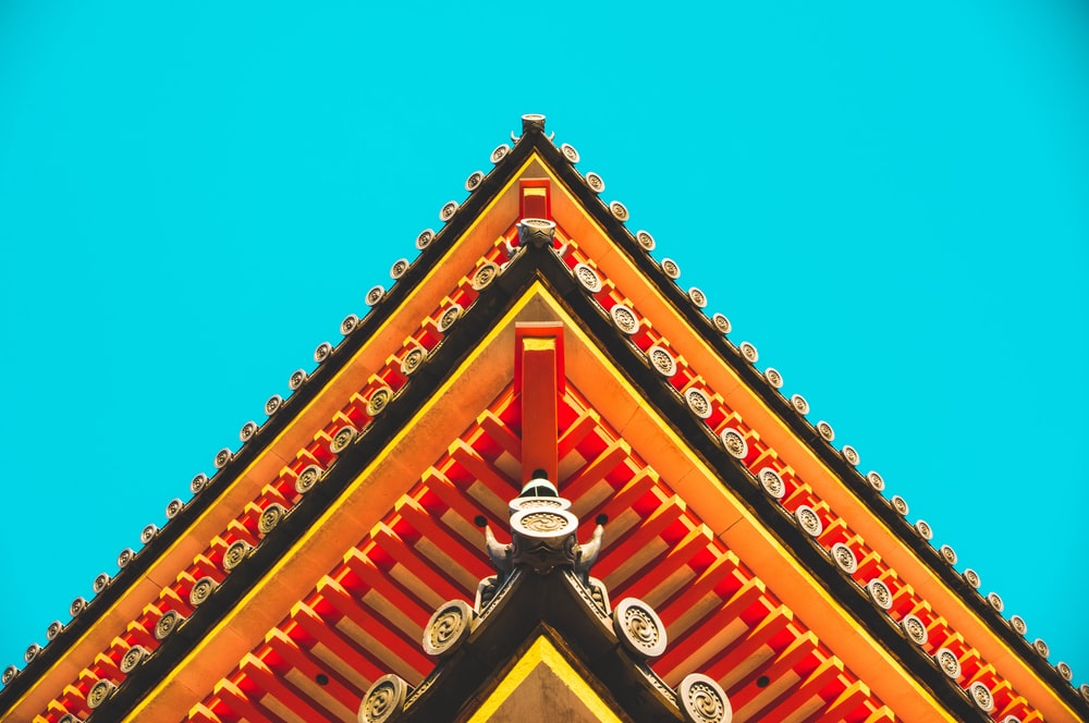 red and black temple under blue sky during daytime