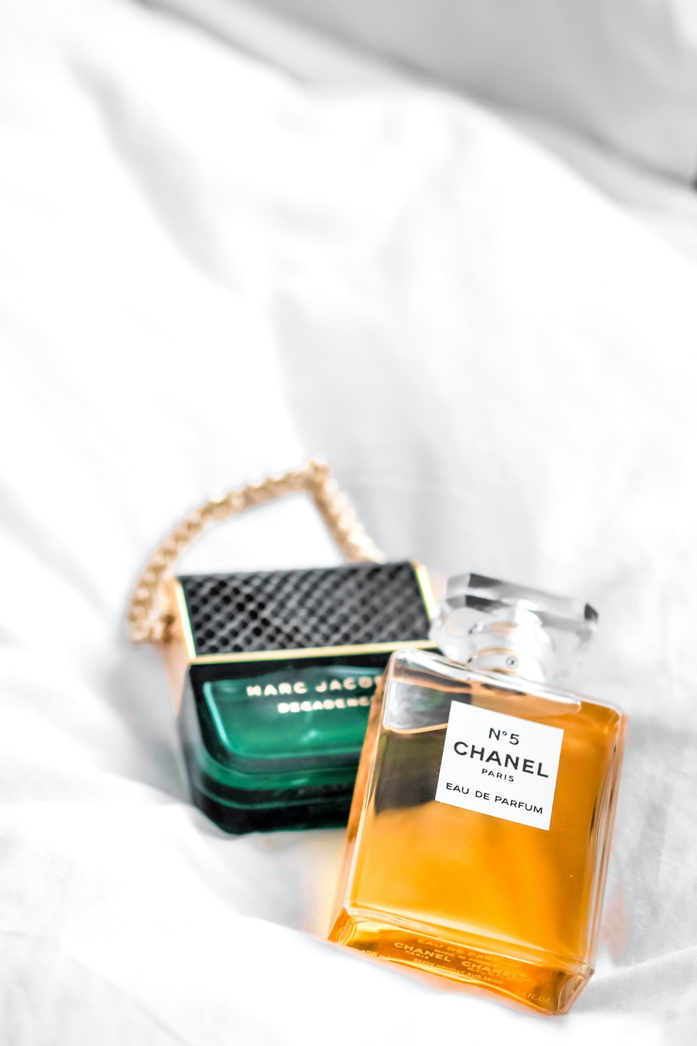 gold and green perfume bottle