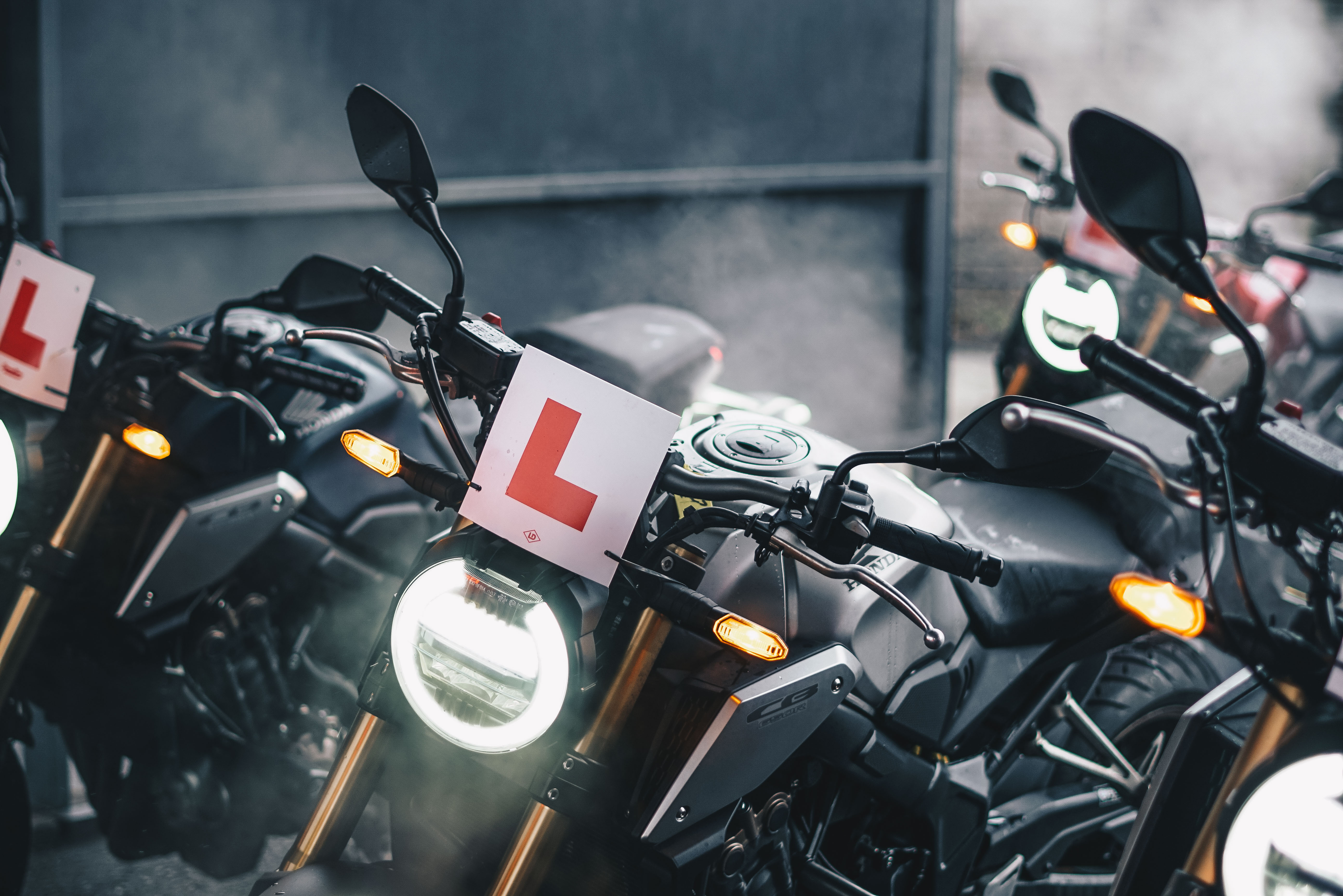 black motorcycle parked beside wall