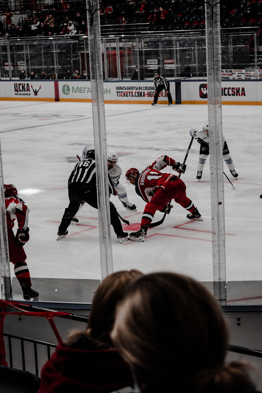 2 men in ice hockey jersey playing ice hockey