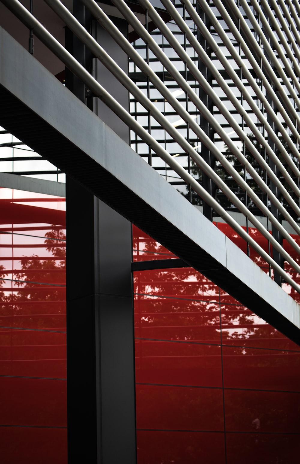 black metal railings near red wall