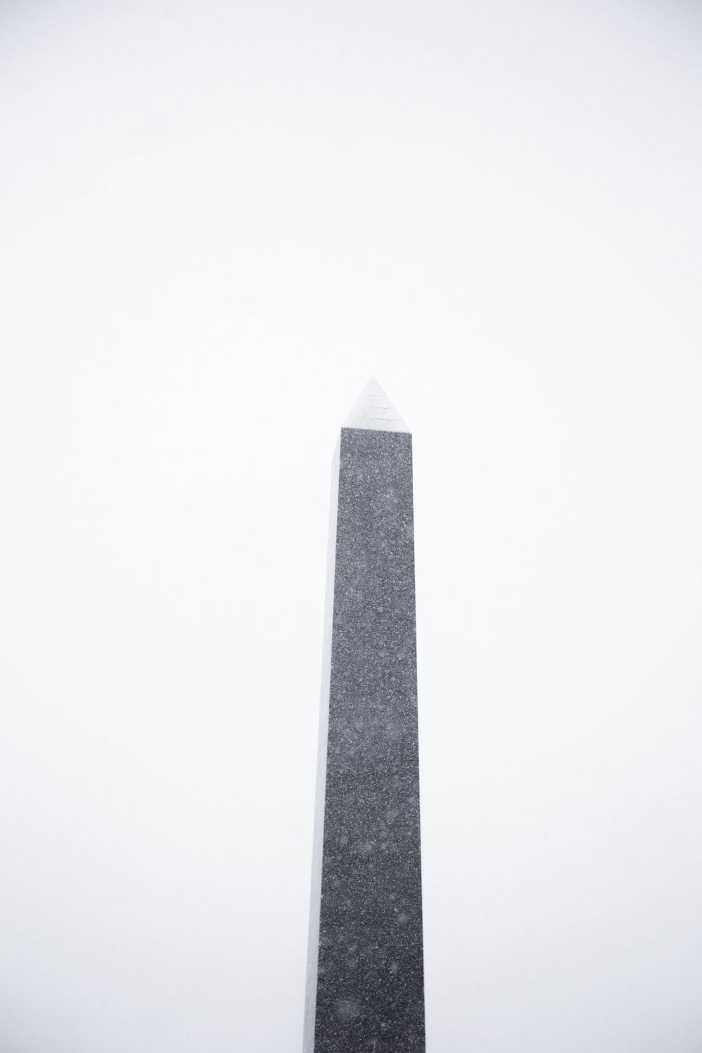 gray concrete tower under white sky