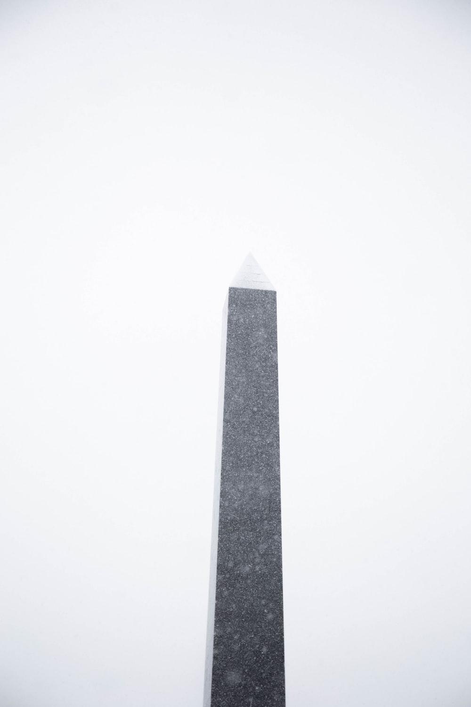 gray concrete tower under white sky