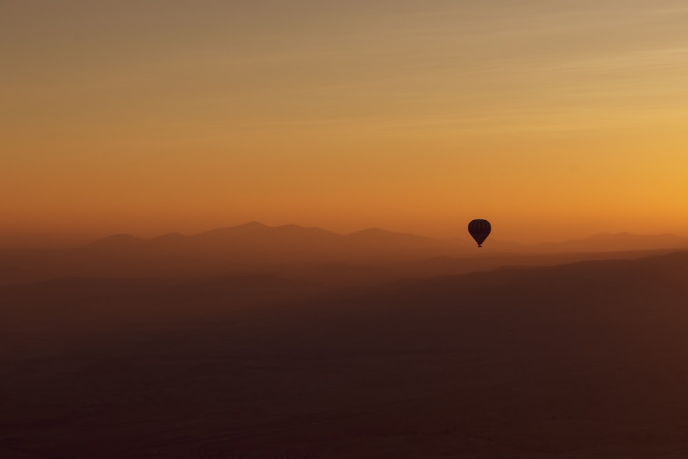 hot air balloon in the sky during sunset