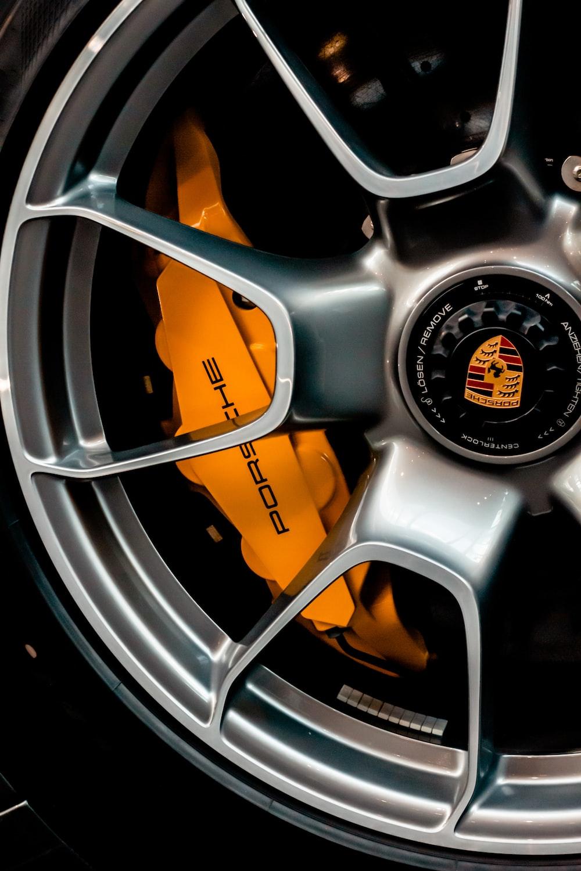 grey and orange multi spoke car wheel