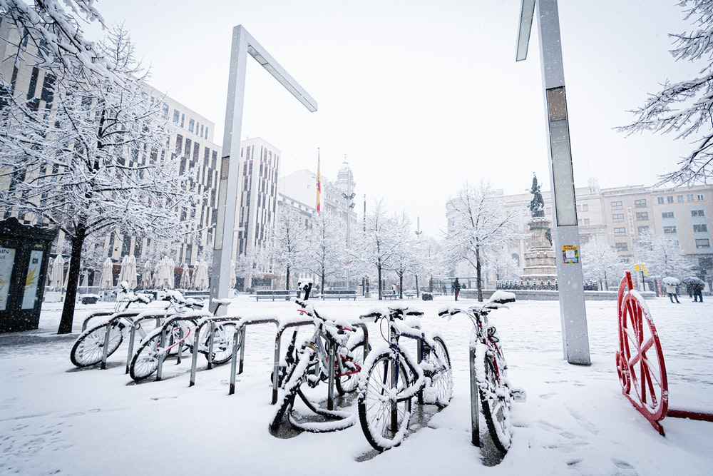 bicycles parked on snow covered ground