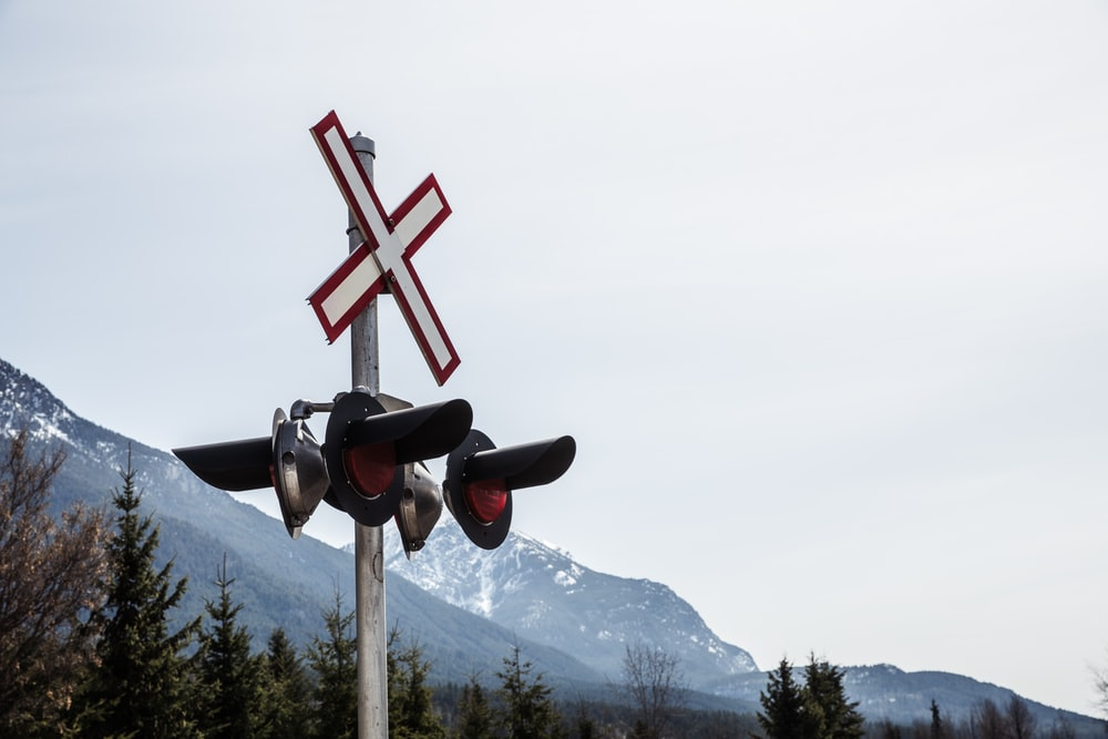 red and black cross on top of mountain during daytime