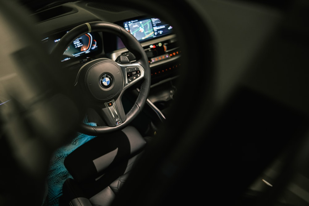 black and gray bmw car steering wheel