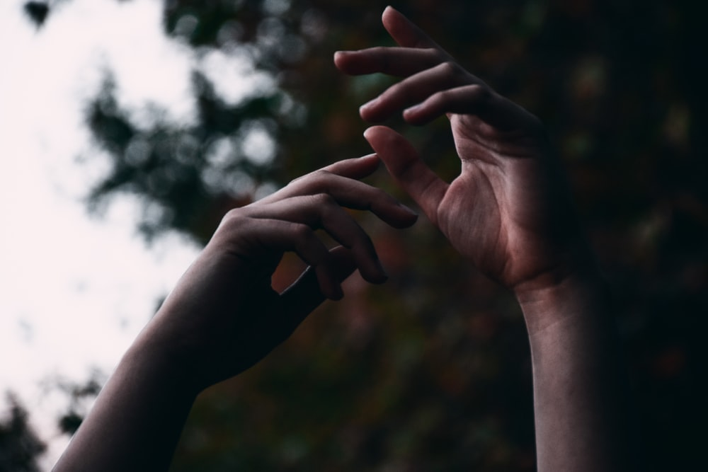 persons hand doing heart sign