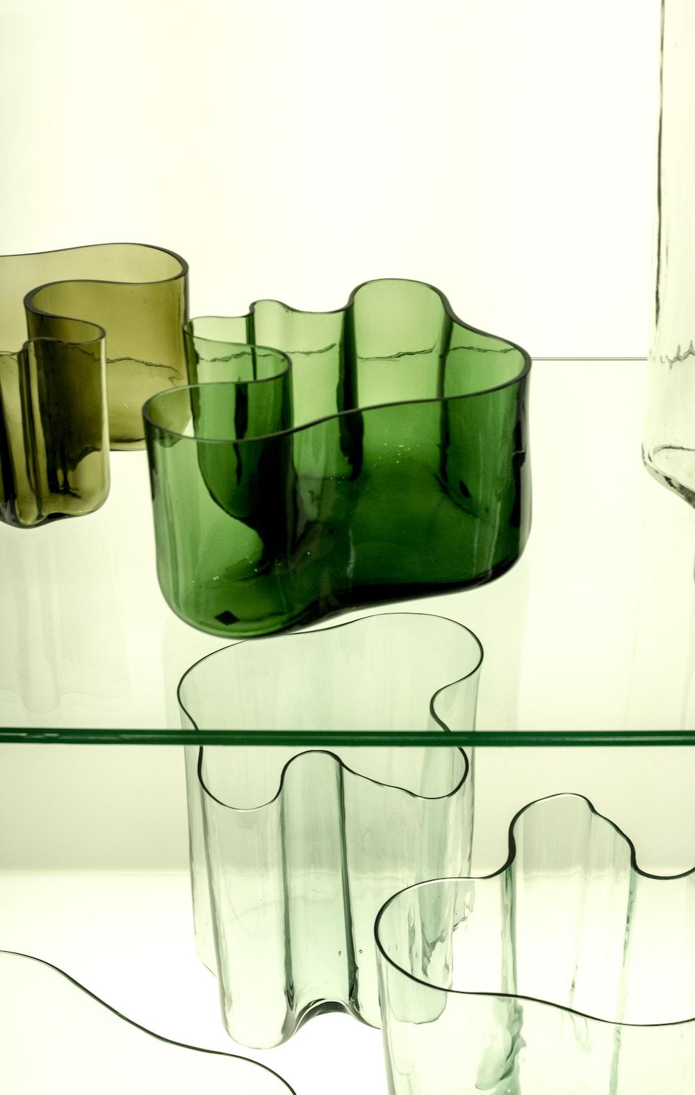 green glass vase on white table