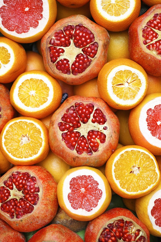 sliced orange fruit on white ceramic plate