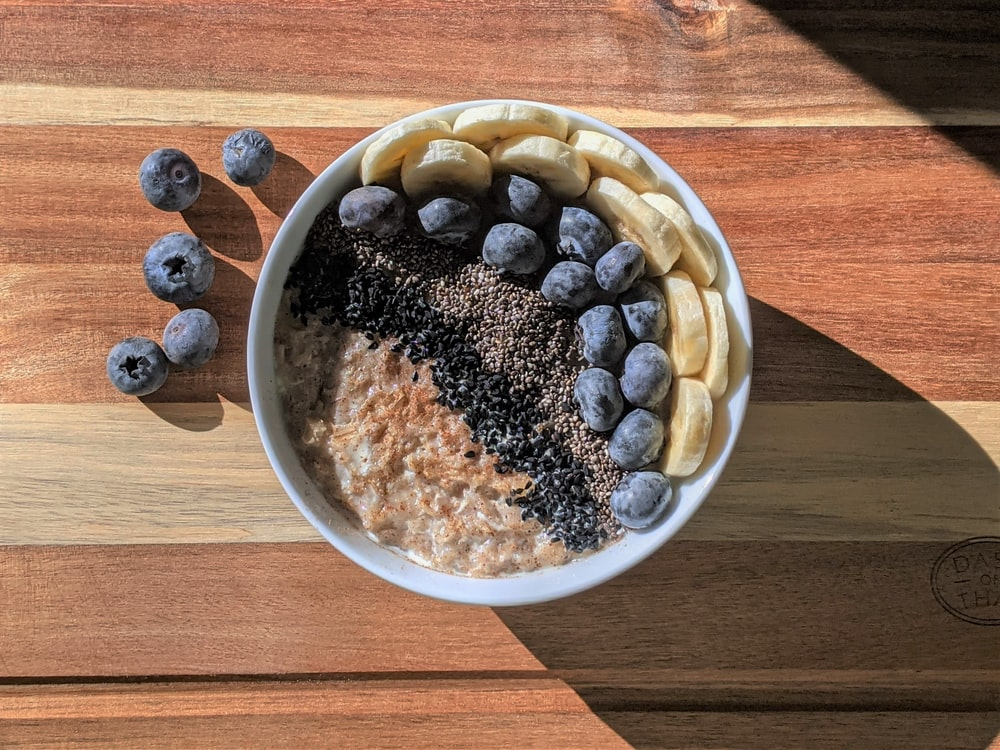 brown and black beans in white ceramic bowl