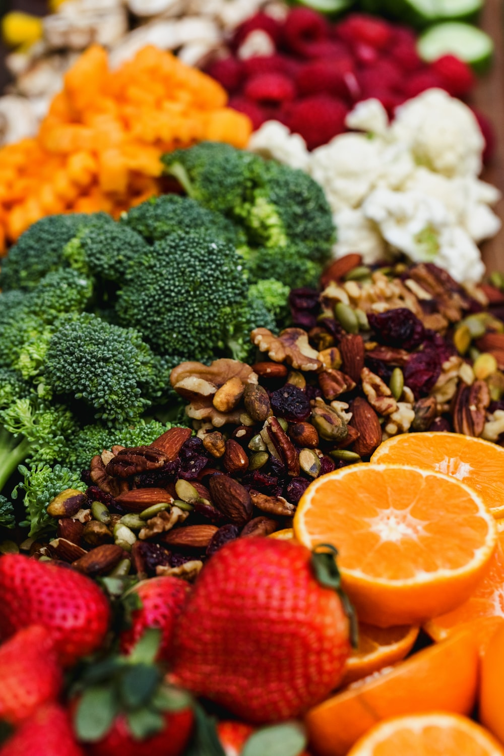 sliced orange fruit and green broccoli