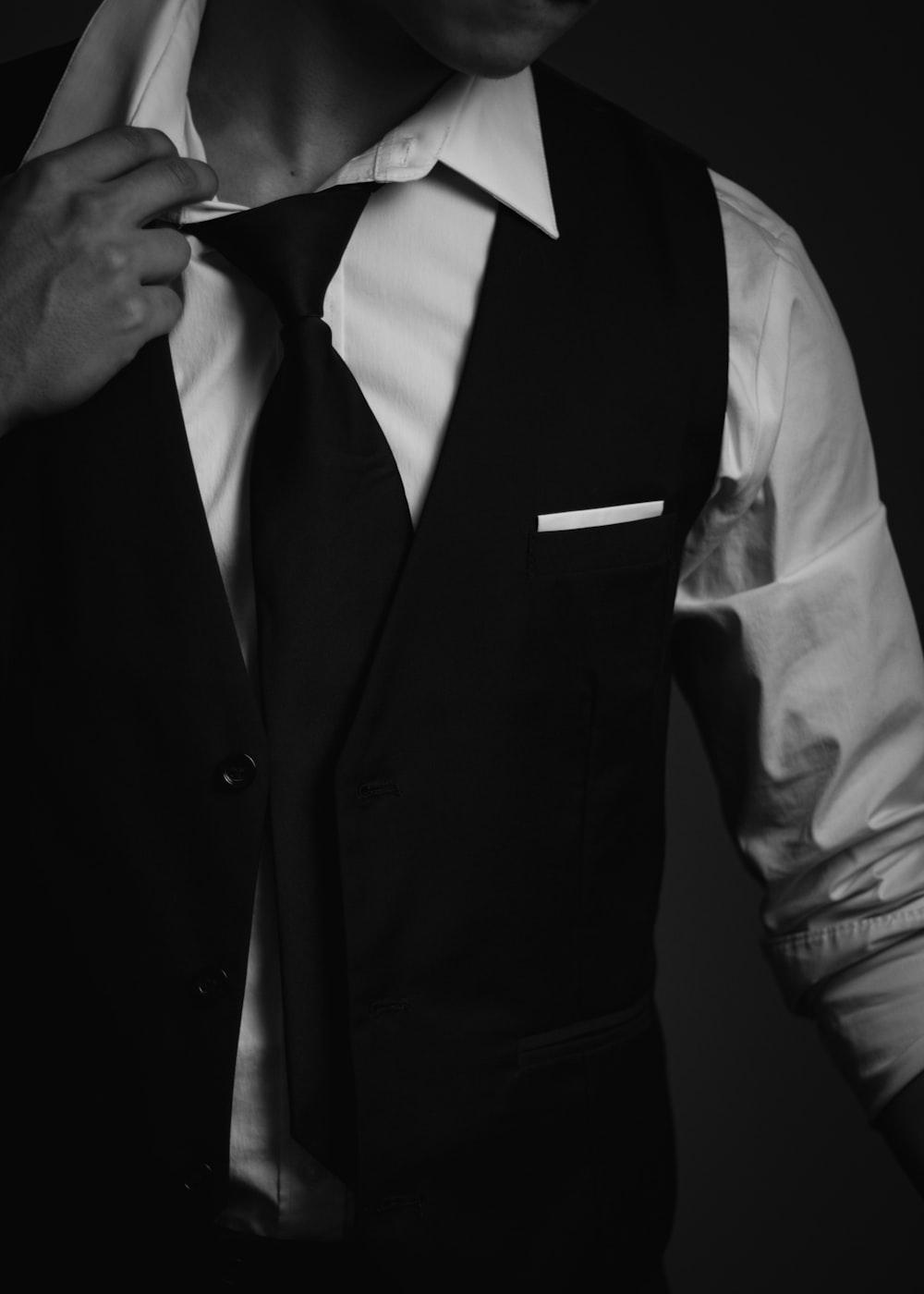 man in black vest and white dress shirt