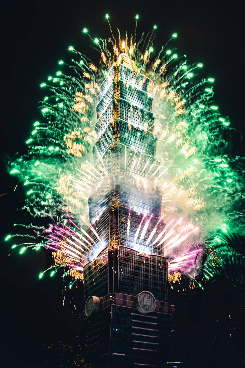 green and yellow fireworks display during nighttime