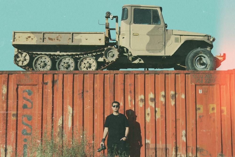 2 men standing beside truck during daytime
