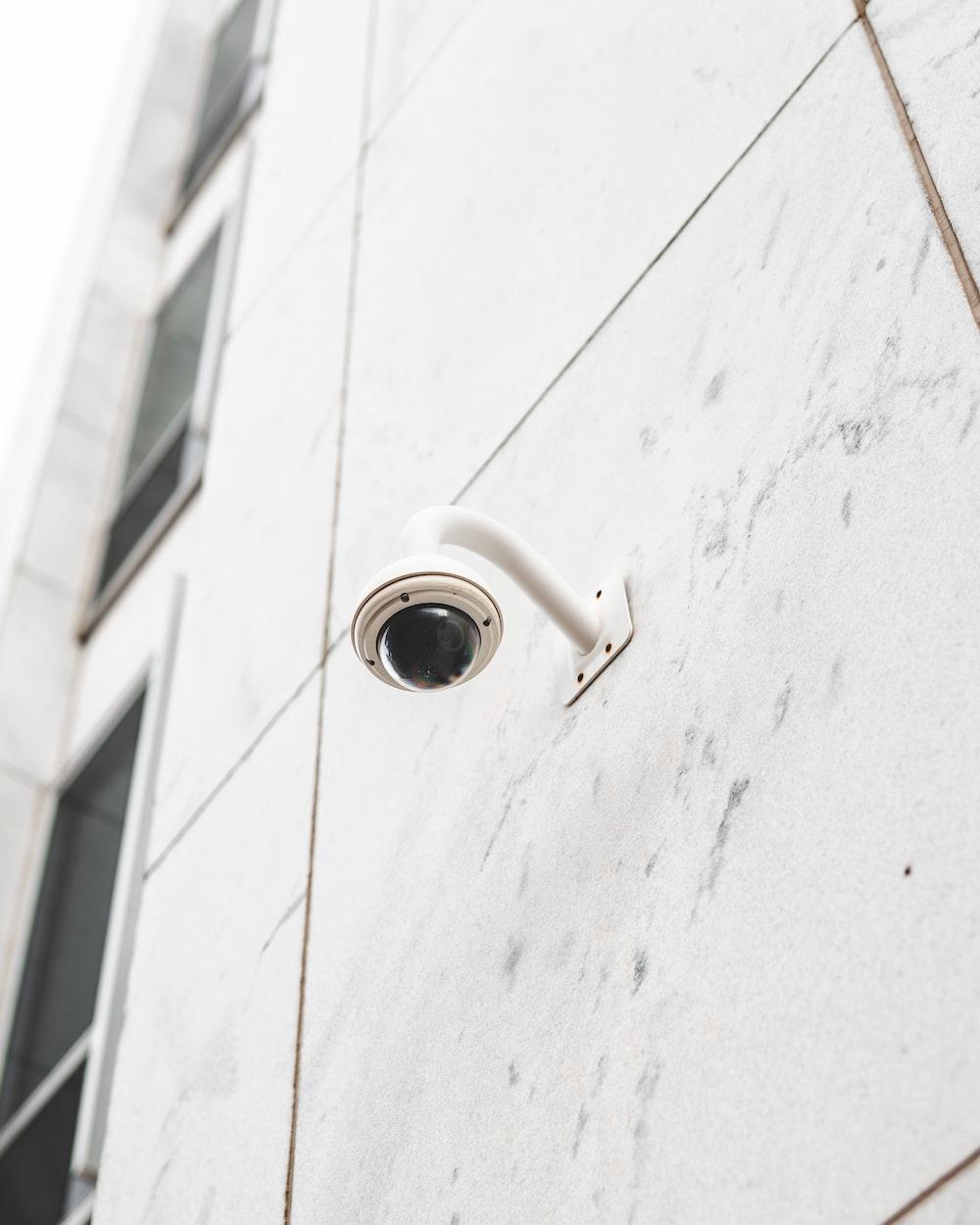 white round light bulb on white concrete wall