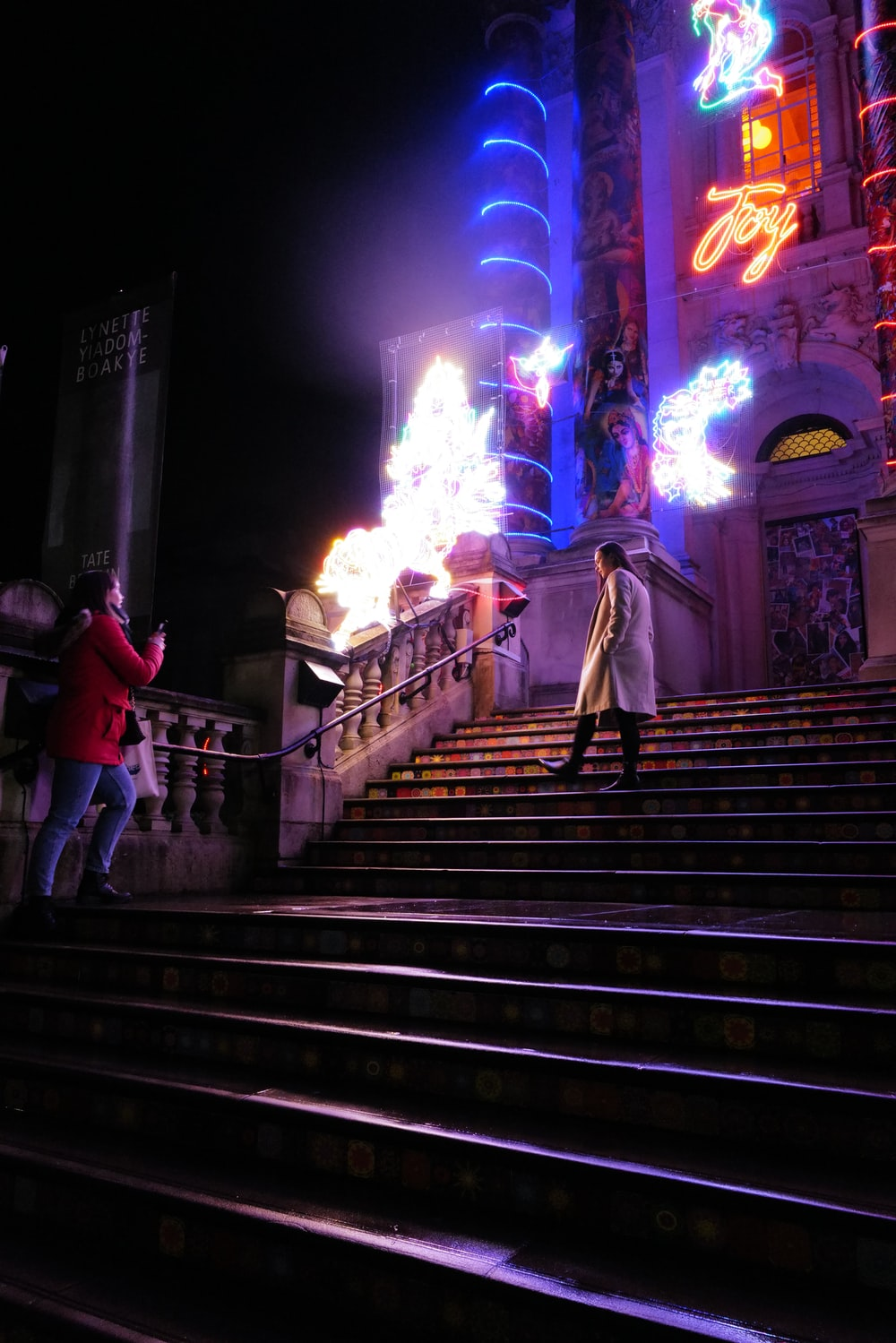 people walking on stairs during nighttime