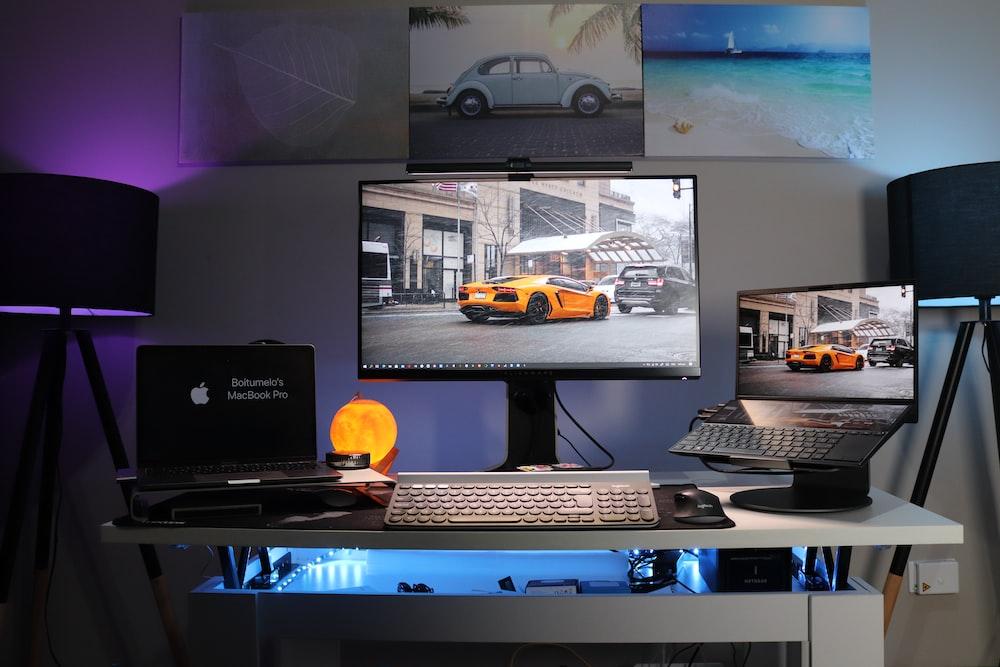 black laptop computer on white desk
