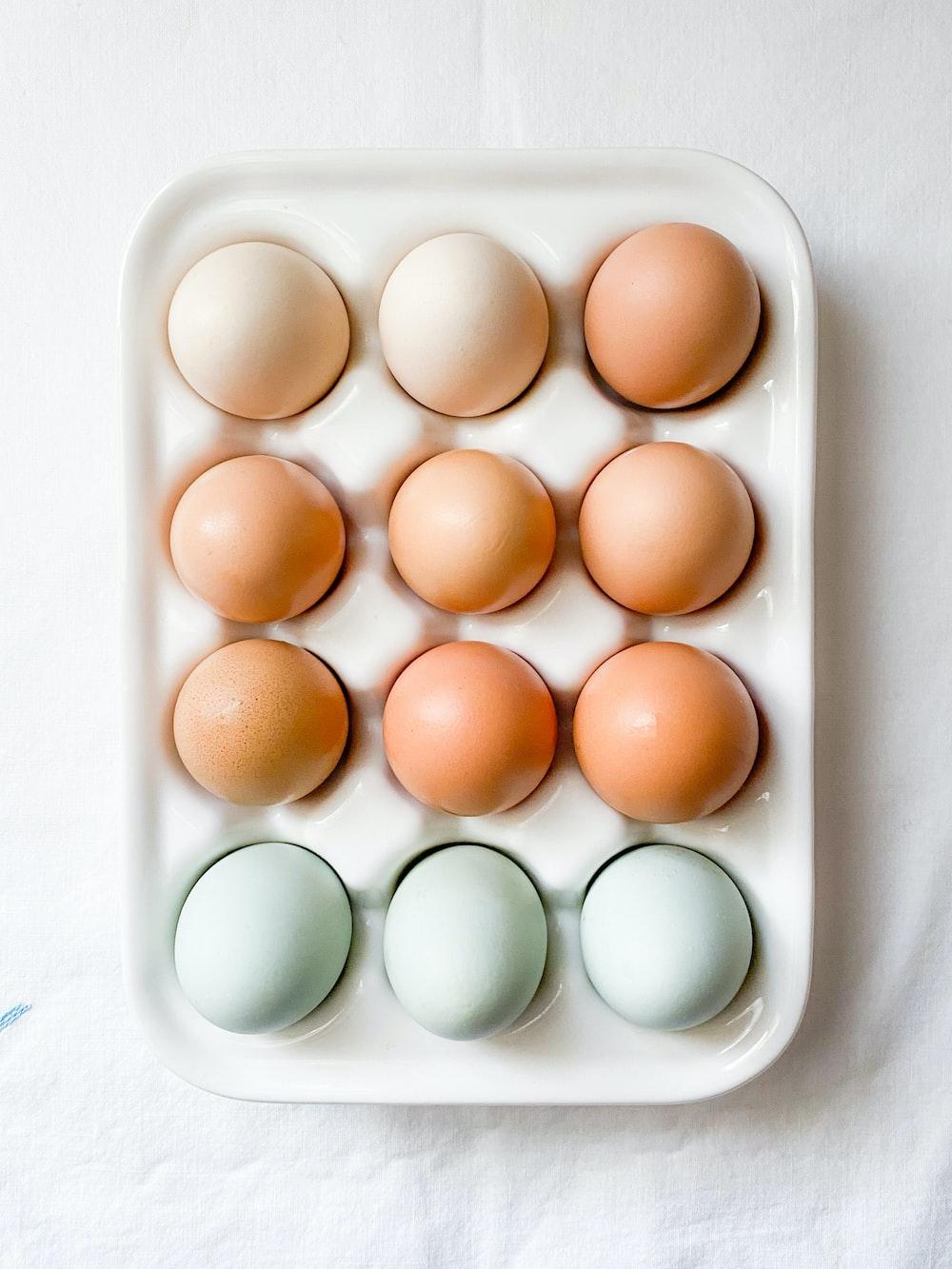 brown eggs on white tray