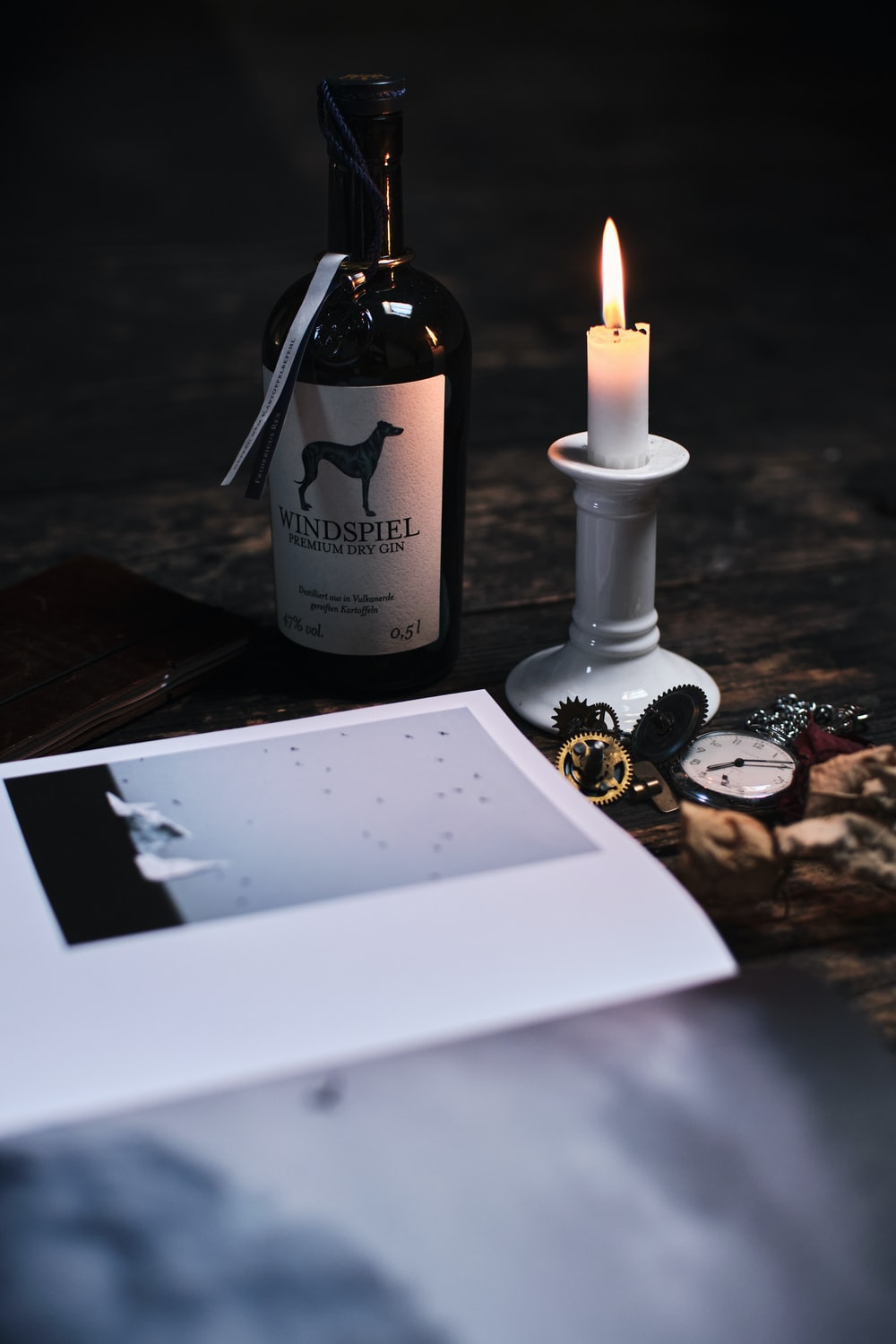 white candle on black wooden table