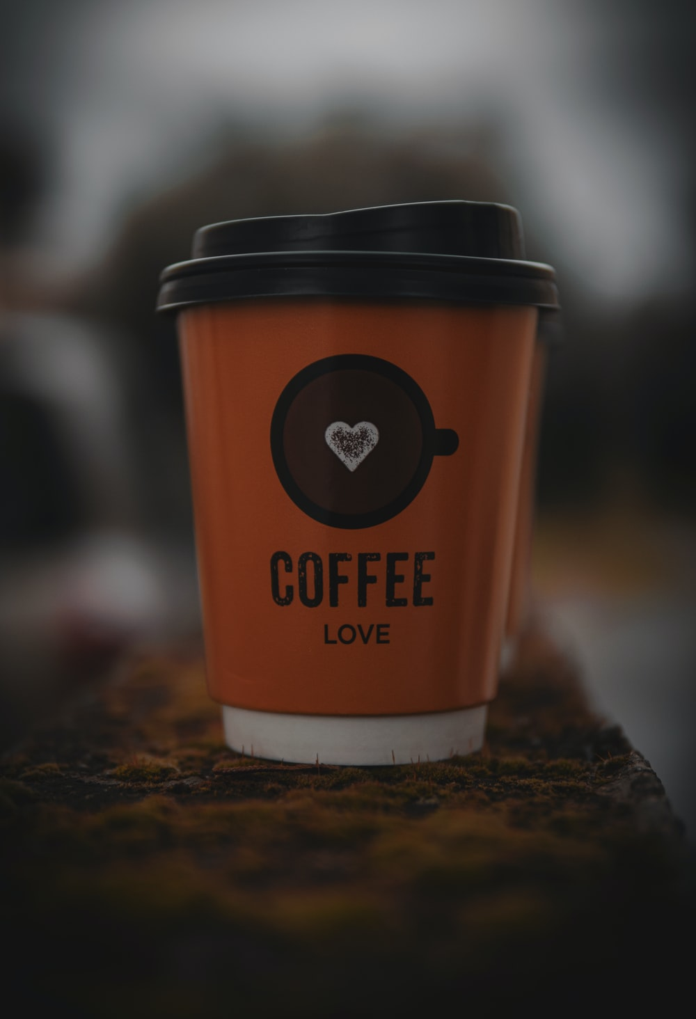 brown and white coffee cup