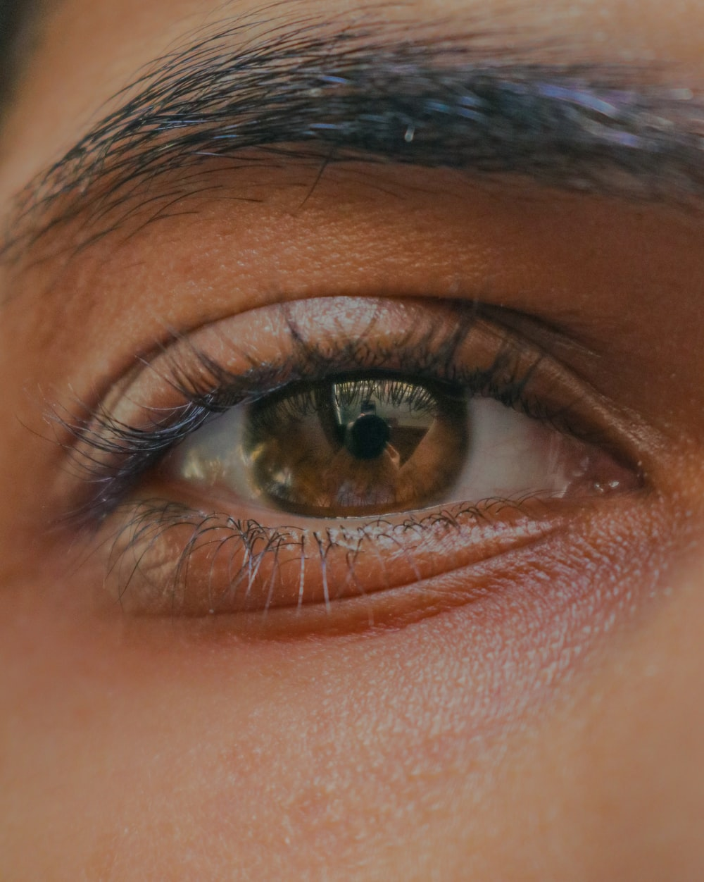 persons eye in close up photography