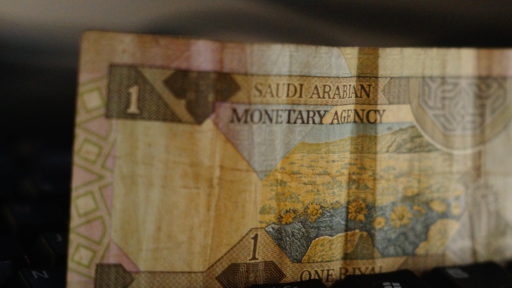 banknote on brown wooden table