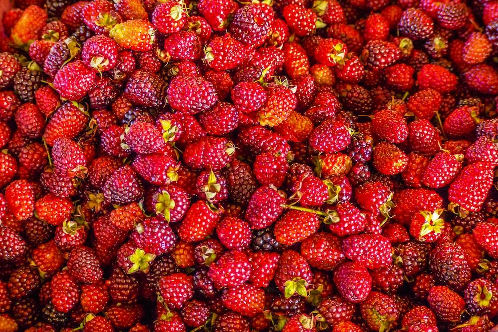 red strawberries on white ceramic plate