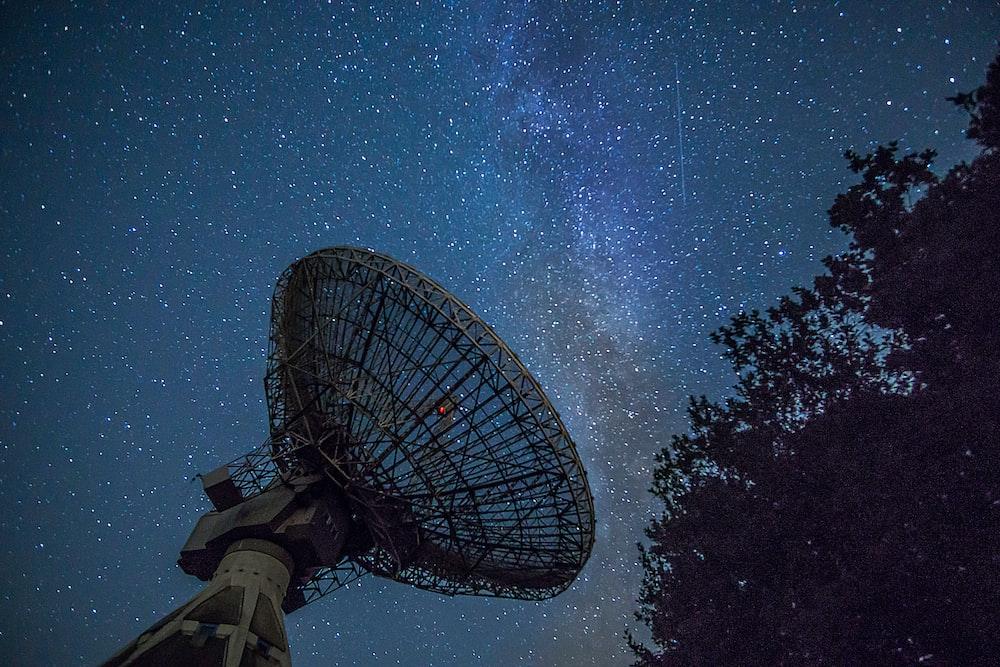 white satellite dish under blue sky during night time