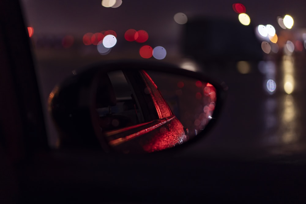 car side mirror with water droplets