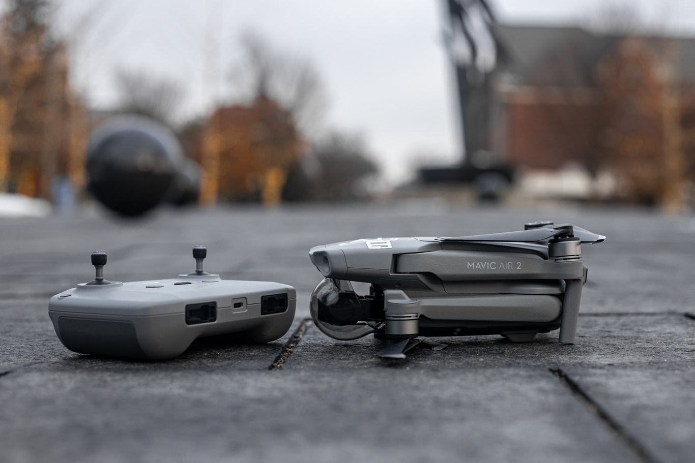 white and black drone on gray concrete floor