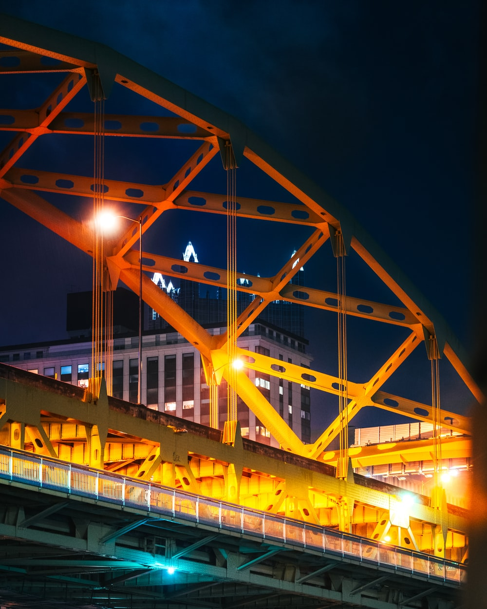 yellow lighted bridge during night time