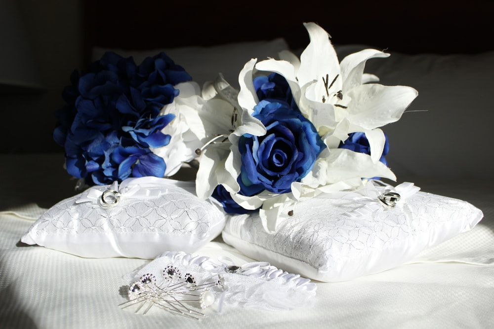 yellow and white roses on white textile