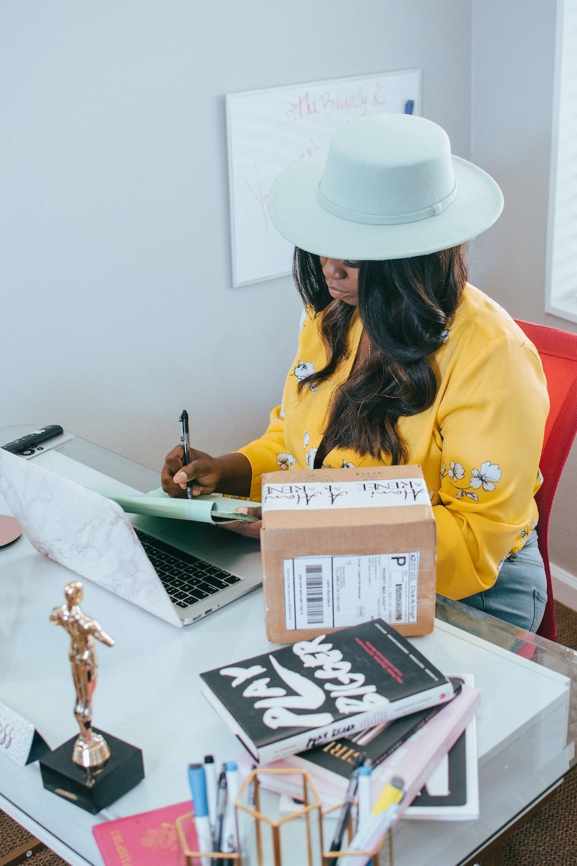woman in yellow long sleeve shirt wearing white cowboy hat
