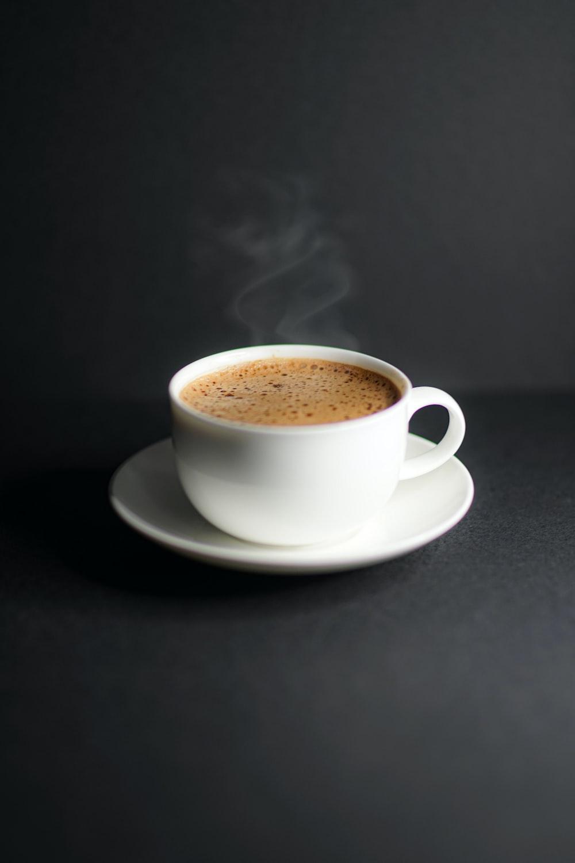 white ceramic cup on white ceramic saucer