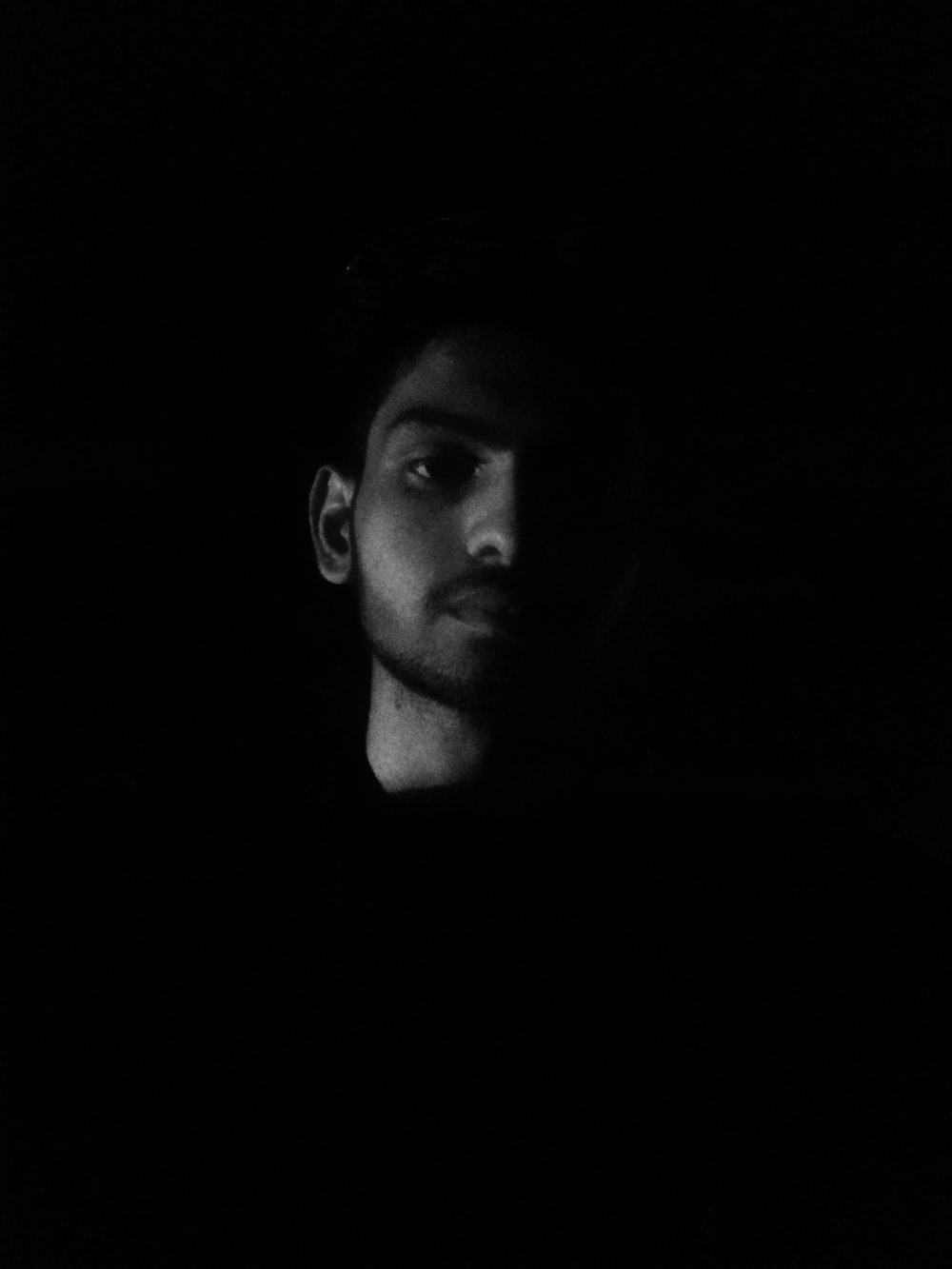 mans face in grayscale photography