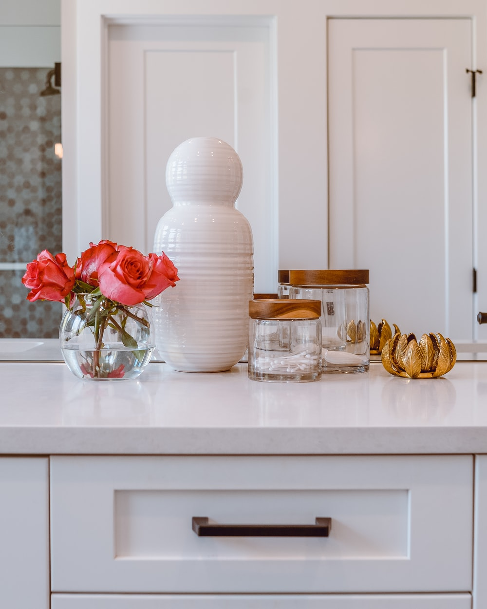 clear glass jars on white wooden table