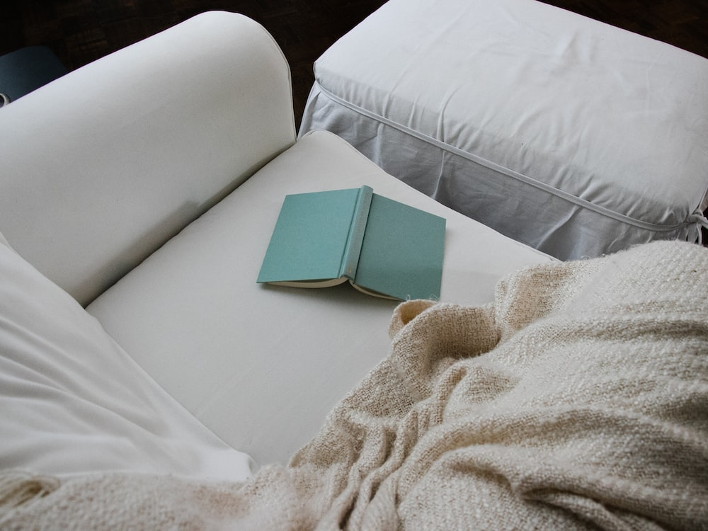 white book on white bed