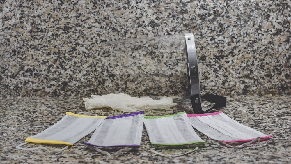 purple and white textile on brown and black marble table