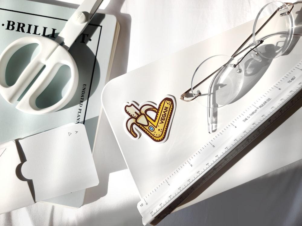 white and black eyeglasses on white paper