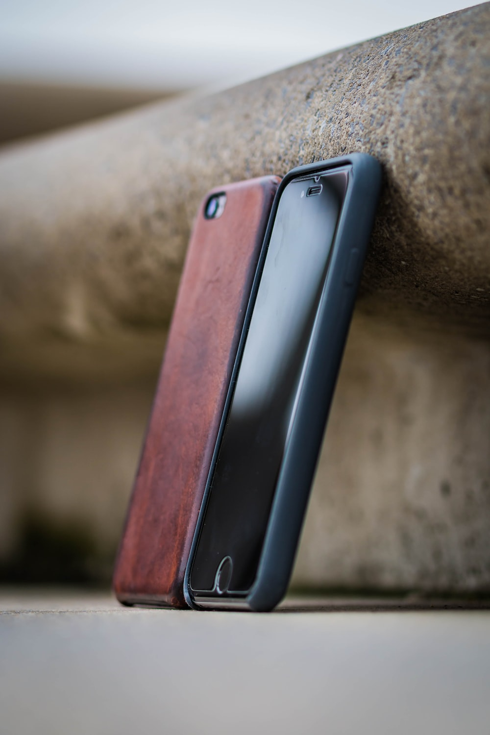 silver iphone 6 with brown leather case