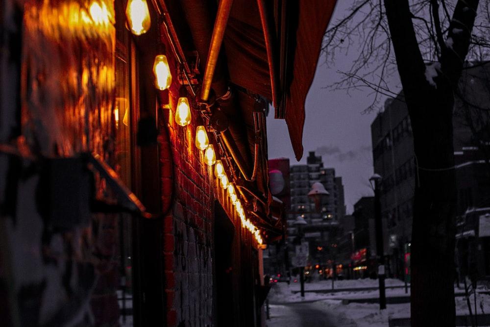 brown umbrella on street during night time